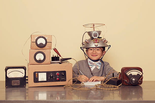 japanese nerd boy wearing mind reading helmet - genius stock photos and pictures