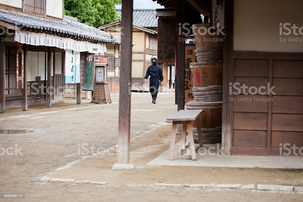Japanese Ninja prowling through the village streets stock photo