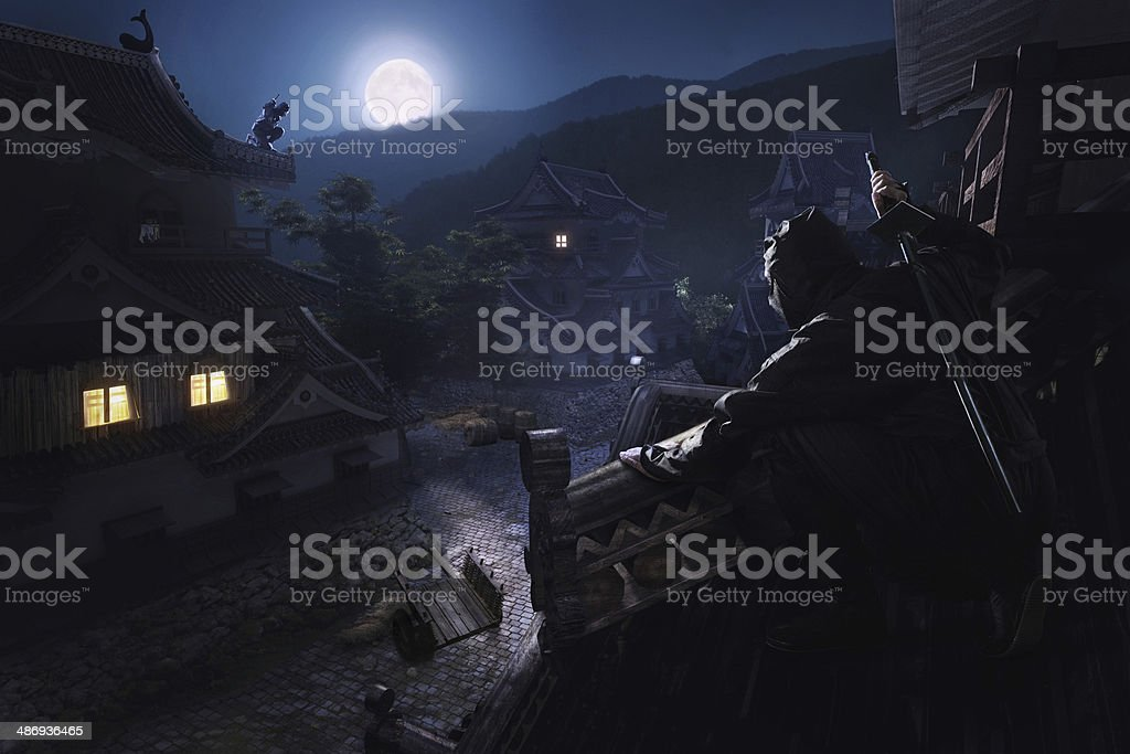 Japanese Ninja Samurai on the roof of the castle stock photo