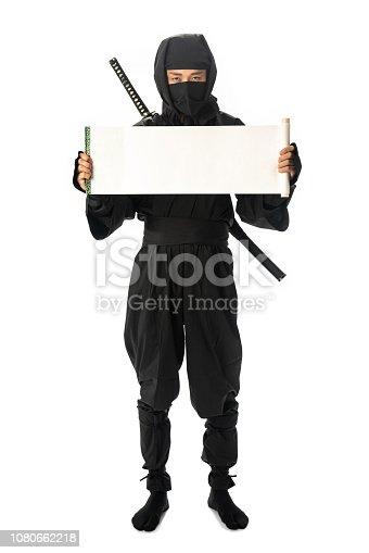 istock Japanese Ninja showing a white scroll. 1080662218