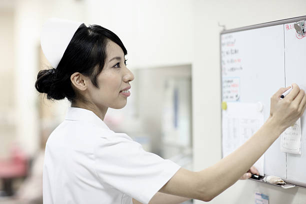 Japanese nurse at work stock photo