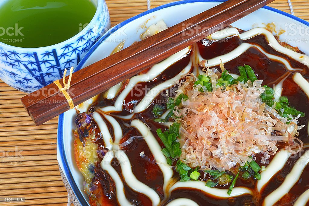 Japanese Okonomiyaki is japanese pizza stock photo