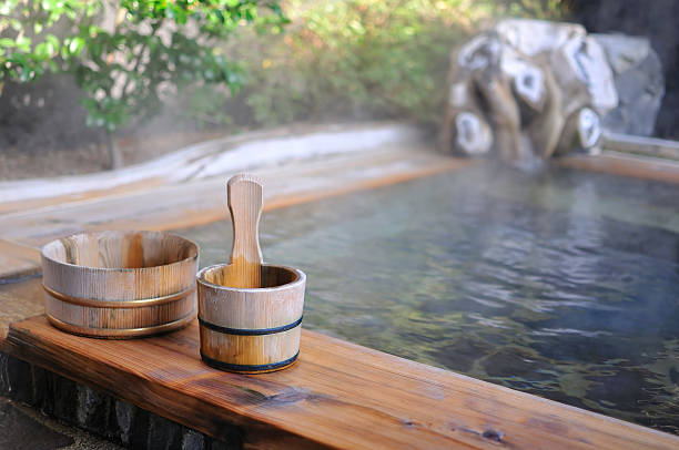 japanese open air hot spa - hot spring stock photos and pictures