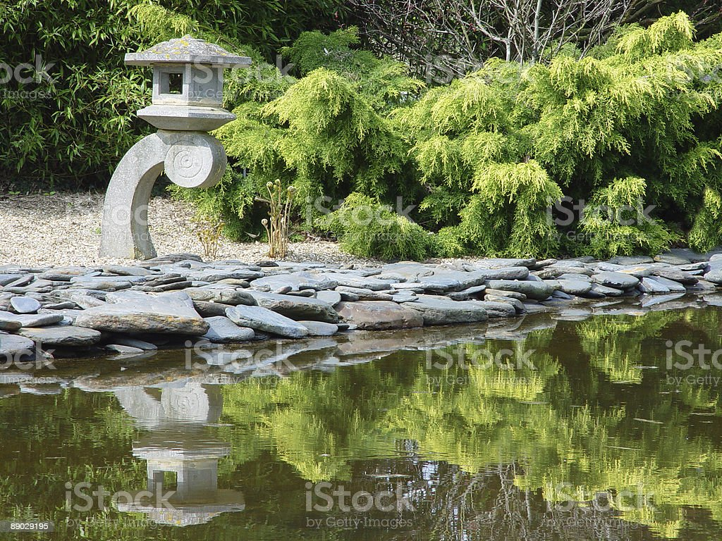 Japanese oriental lantern by pond royalty-free stock photo