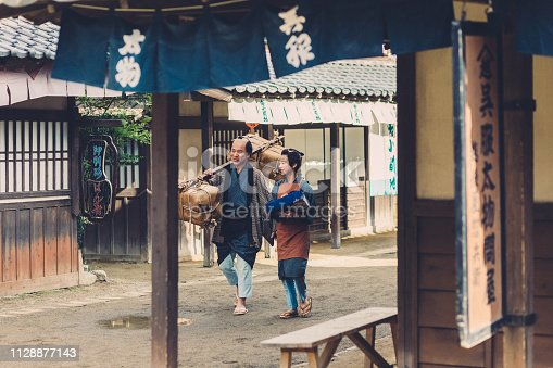 Japanese father and son walking at the village