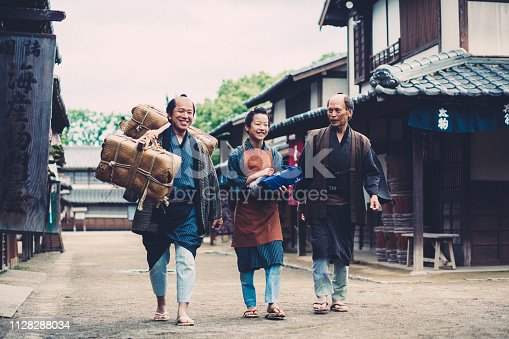 Japanese father,grandfather and son walking at the street