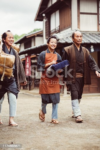 Japanese father, grandfather and son walking at the street