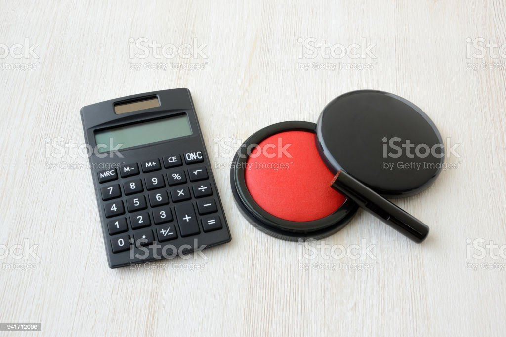 Japanese personal seal and calculator stock photo