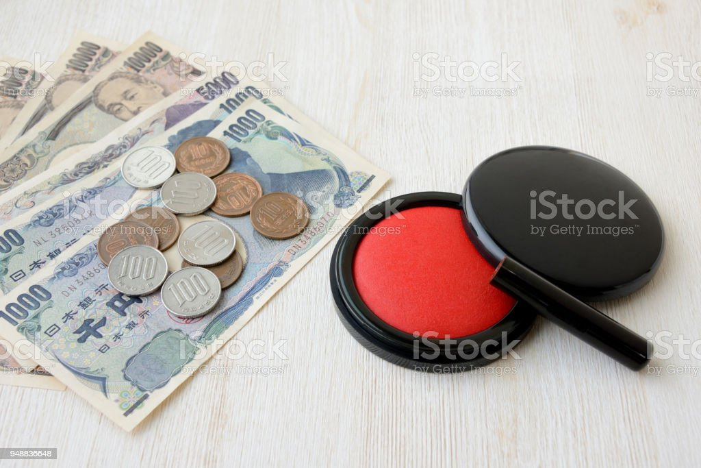 Japanese personal seal and Japanese money stock photo