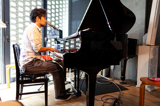 Japanese pianist performing at stage