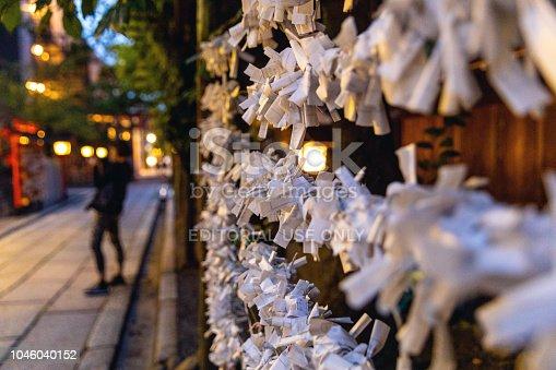 Kyoto, Japan - September 11, 2018: Japanese prayer paper 'Omikuji' in a temple at night in Kyoto, Japan