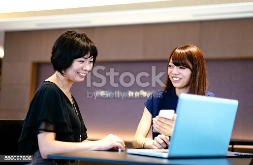 589445574istockphoto Japanese professionals in office feeling positive about business outcomes 586067606