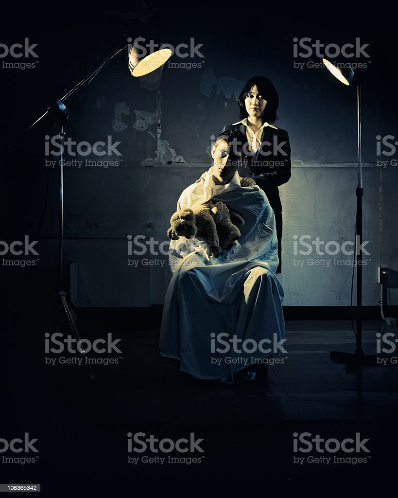 japanese psychiatrist posing with a patient royalty-free stock photo