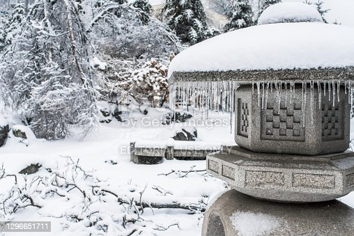 istock Japanese rock garden after a winter ice storm. 1296651711