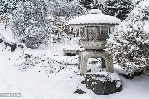 istock Japanese rock garden after a winter ice storm. 1296651767