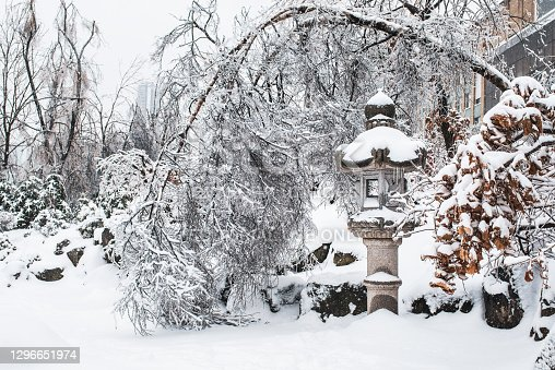 istock Japanese rock garden after a winter ice storm. 1296651974