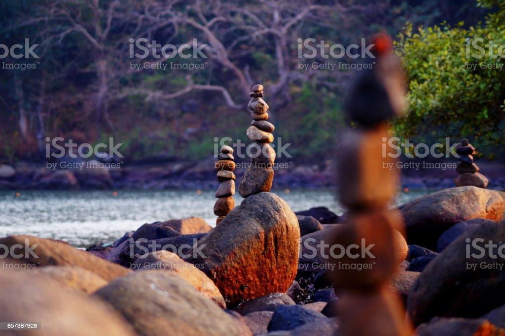 Japanese rock garden on Palolem beach in Goa, India. Zen stones....
