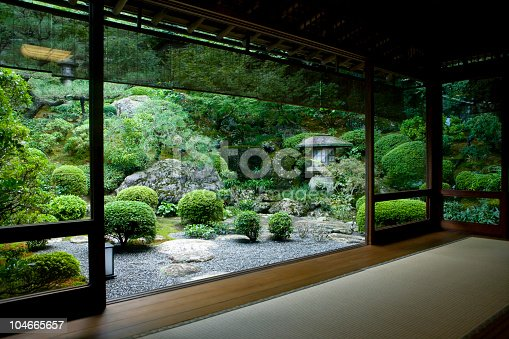 Japanese garden seen from inside a traditional tatami room.