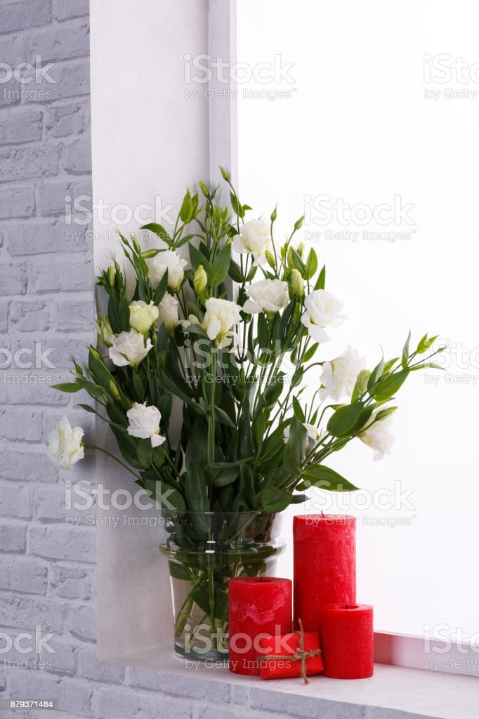 Japanese Roses In A Vase Next To Candles And A Small Gift On The Windowsill Stock Photo Download Image Now Istock