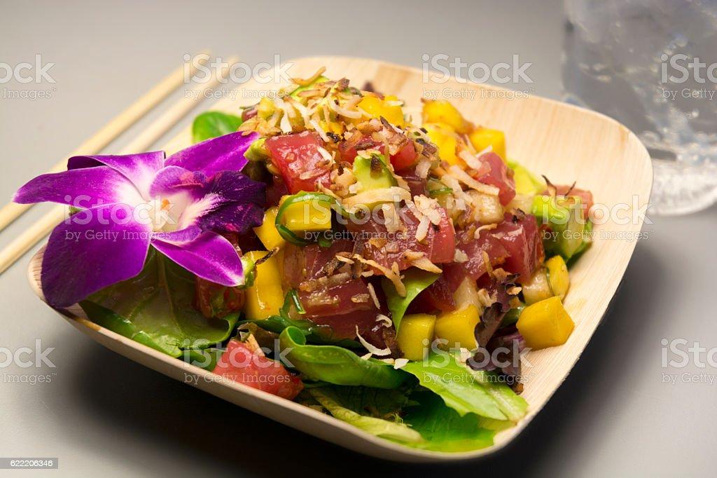 Japanese Salmon Sashimi Salad With Pineapple And Purple Orchid stock photo