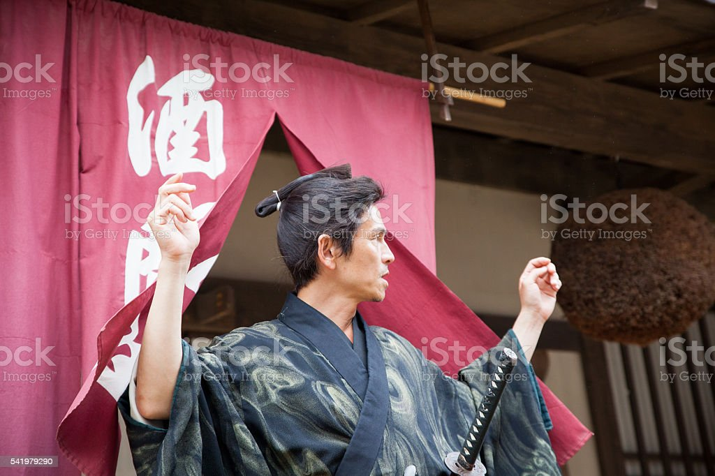 Japanese Samurai in full clothing gets ready stock photo