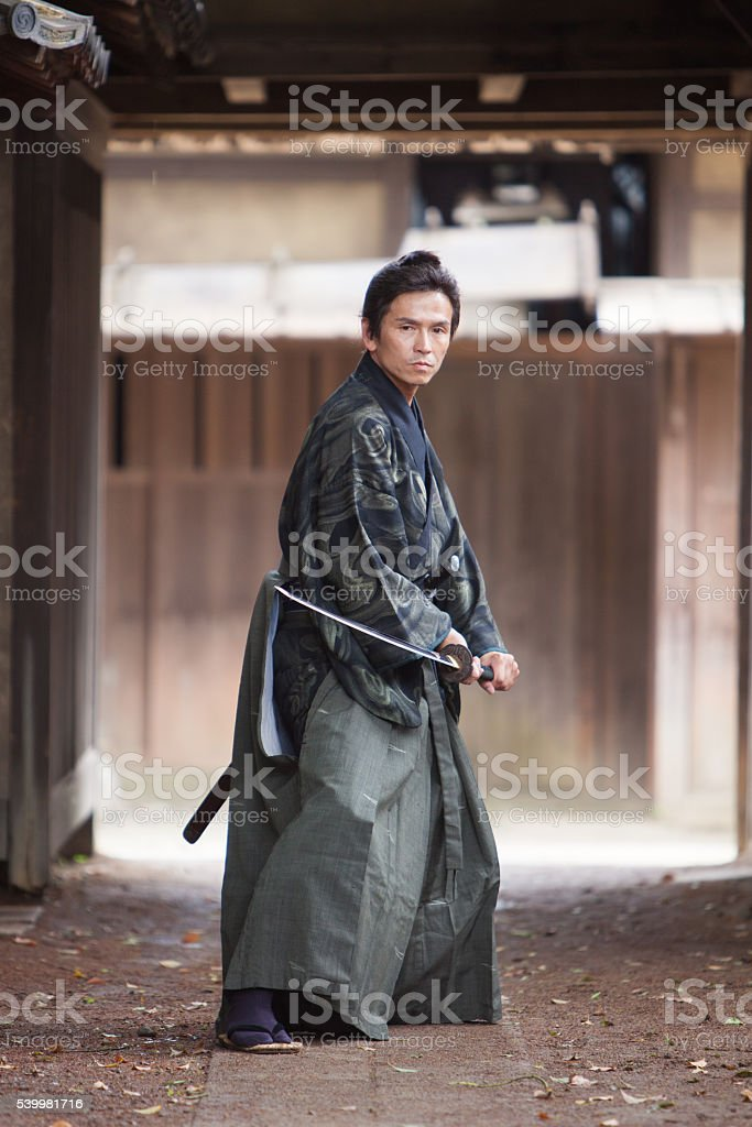 Japanese Samurai stands ready for battle stock photo