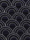Japanese sashiko hand quilting in seikaiha (ocean waves) pattern
