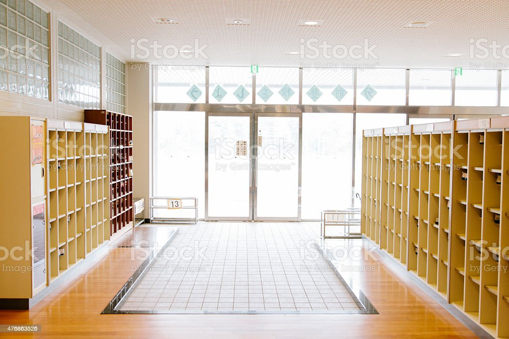 Japanese school locker room, changing room with shelves, pigeon holes stock photo