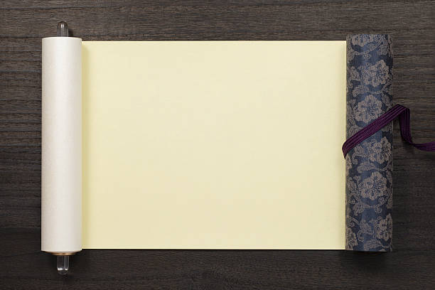 japanese scroll on dark wooden background stock photo