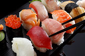 many tasty fresh japanese sushi with tuna, caviar and shrimp