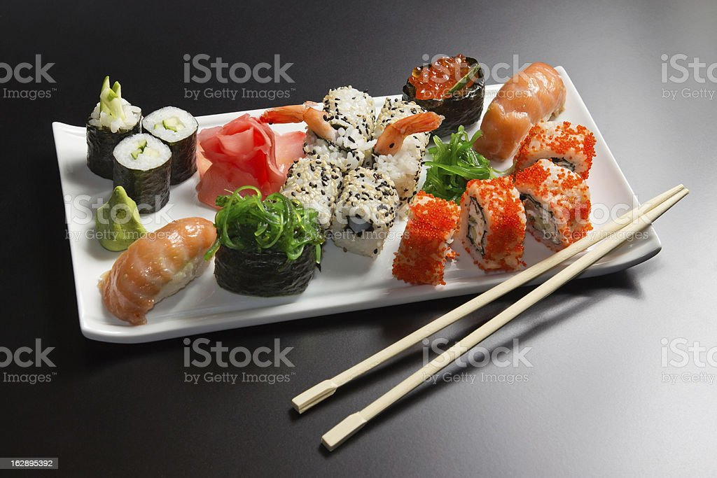 Japanese  seafood  sushi , rolls and chopstick royalty-free stock photo