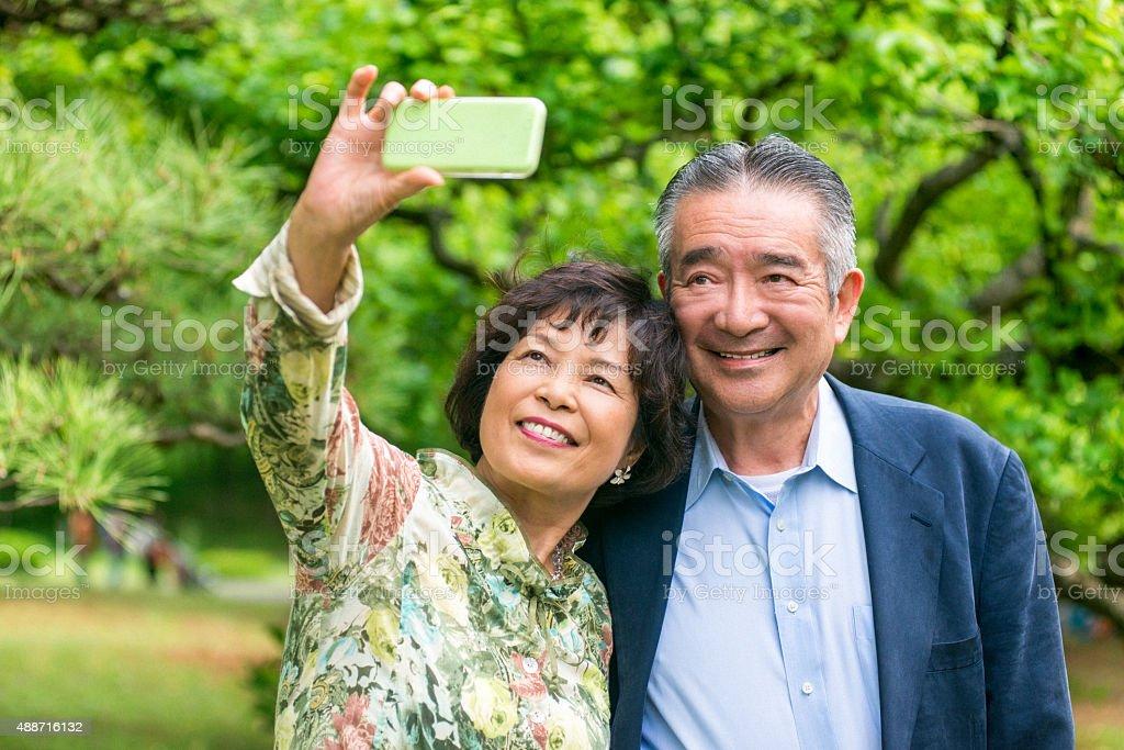 Japanese senior couple taking a selfie stock photo