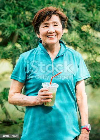 851958232istockphoto Japanese senior woman with healthy drink 488407628