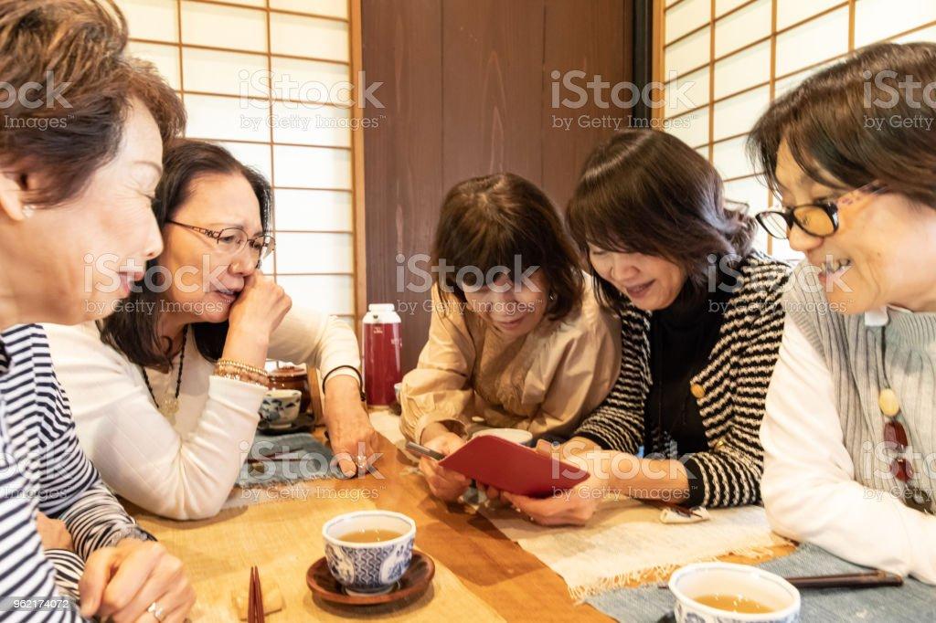 5 Japanese senior women at restaurant stock photo
