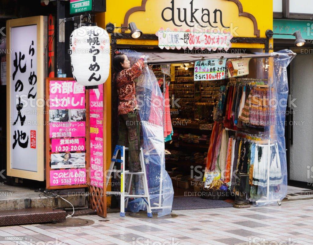 Japanese Shopkeeper in Shinjuku royalty-free stock photo
