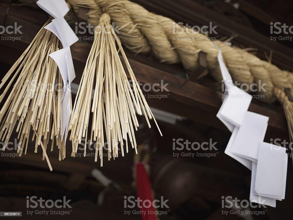 Japanese shrine rope and straw decoration royalty-free stock photo