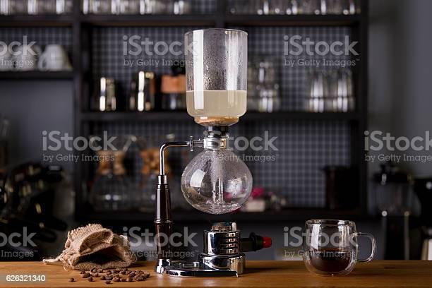 Japanese siphon coffee maker with halogen beam heater picture id626321340?b=1&k=6&m=626321340&s=612x612&h=eylaovigj9bppemthn0jvxbebx3r36dnbah6uwxex0i=