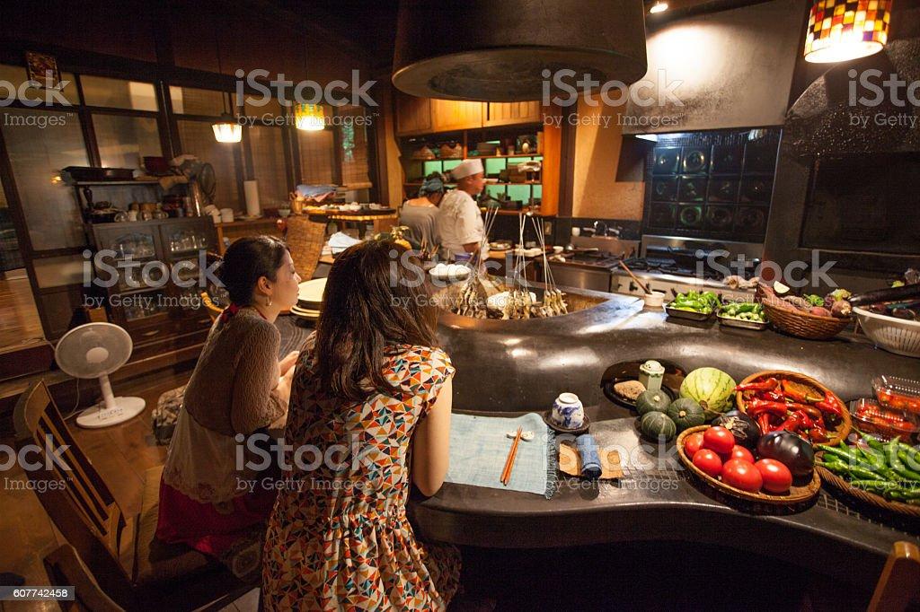 Japanese sisters at a traditional Japanese restaulant stock photo