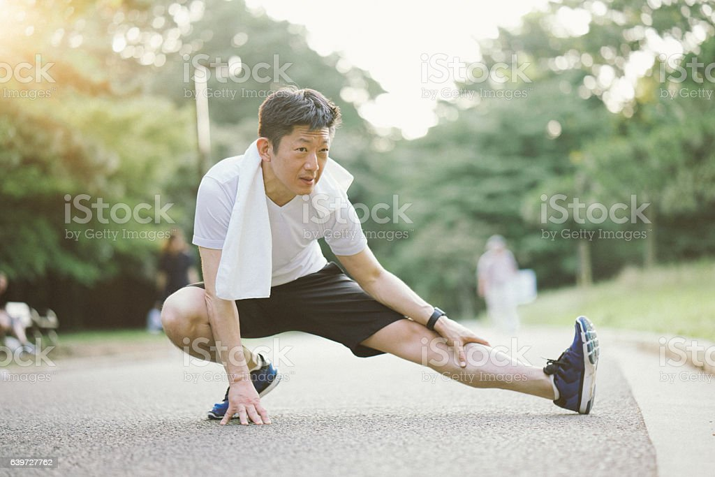 Japanese Sport Man Exercising Outdoors In The Early Morning stock photo