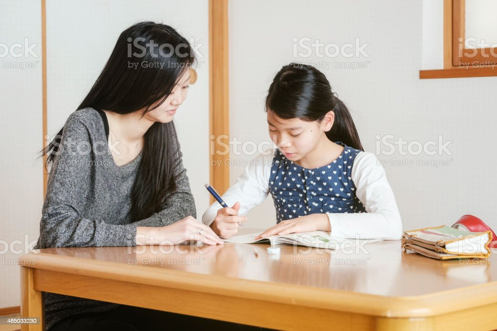 Japanese Student with Tutor stock photo