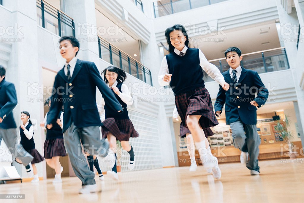 Japanese Students running to recess stock photo