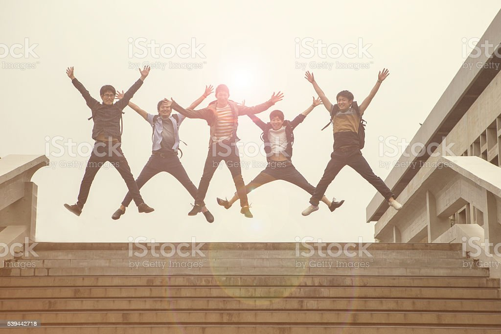 japanese students together cheering with friend classmates in kyoto japan stock photo