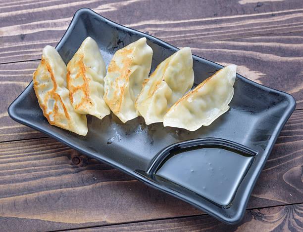 japanese style fried dumpling gyo-za witch sho-yu sauce on dish, - cooking sho bildbanksfoton och bilder