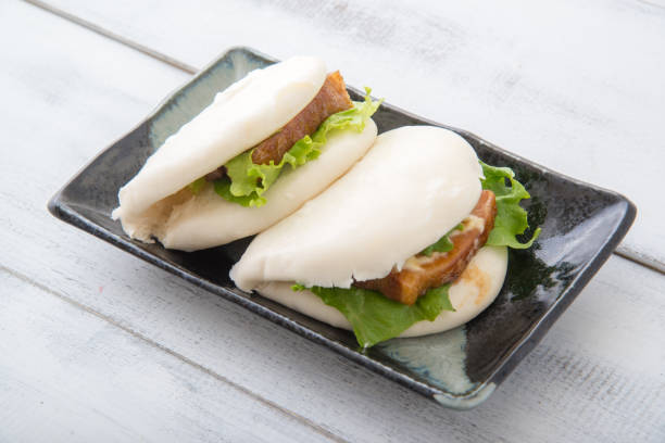 japanese style pork buns with pork belly stock photo