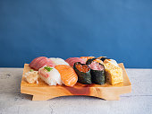 Japanese sushi. A plate with fresh seafood such as tuna, salmon, and salmon roe.