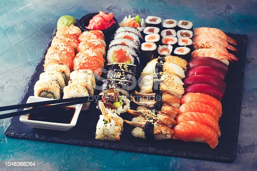 Japanese sushi big set with pair of black chopsticks, toned