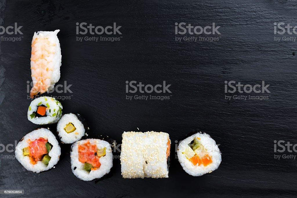 Japanese sushi on black kitchen slate plate. stock photo