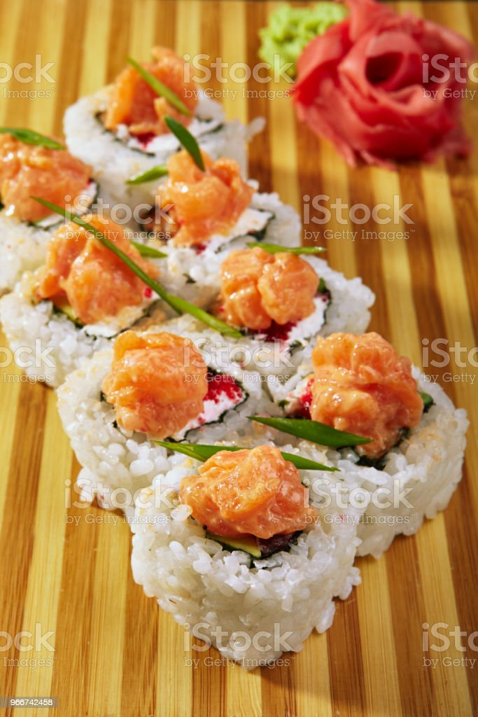 Japanese sushi roll topped stock photo