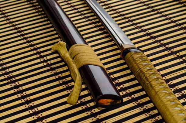 Japanese sword katana on bamboo mat stock photo