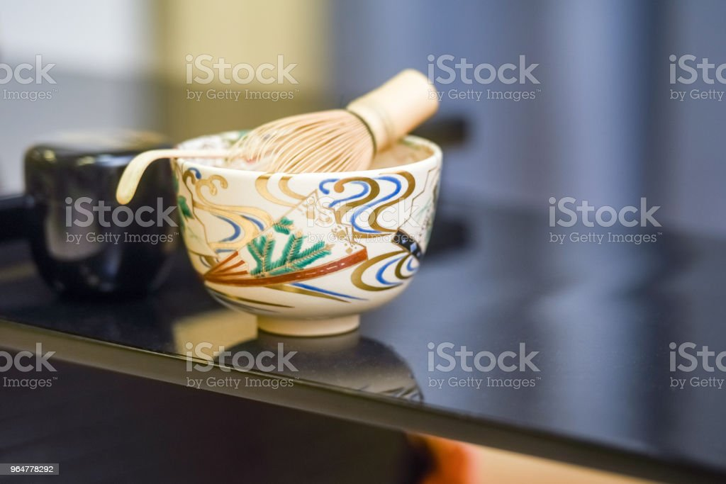 Japanese Tea accessories - cups on Daisuke.  The concept of Japanese folk traditions royalty-free stock photo